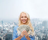 Smiling young woman with us dollar money Royalty Free Stock Photo