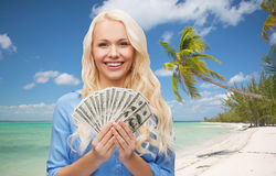 Smiling young woman with us dollar money Royalty Free Stock Photography