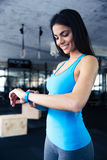 Smiling young woman using activity tracker Stock Photo