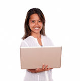 Smiling young woman using her laptop computer Stock Images