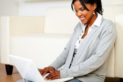 Smiling young woman using laptop Stock Photo
