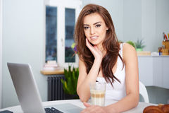 Smiling young woman using laptop Royalty Free Stock Images