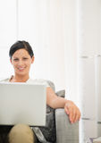 Smiling young woman using laptop Royalty Free Stock Photo