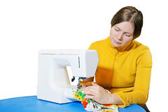 Woman using a sewing machine Royalty Free Stock Image