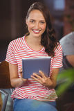 Smiling young woman using tablet computer Royalty Free Stock Image