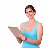 Smiling young woman using tablet pc Stock Image