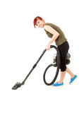 Smiling young woman with a vacuum cleaner Royalty Free Stock Photos