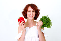 Smiling young woman with vegetables Royalty Free Stock Images