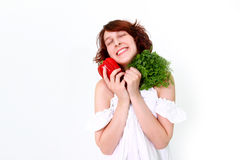 Smiling young woman with vegetables Royalty Free Stock Photos