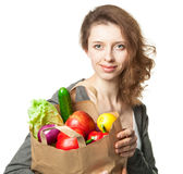 Smiling young woman with vegetables and fruits in shopping bag Royalty Free Stock Images