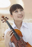 Smiling Young Woman With Violin, Looking Away, Portrait Stock Photo