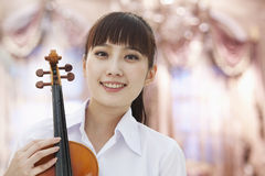Smiling Young Woman With Violin, Looking At Camera, Portrait Stock Photo