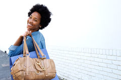 Smiling young woman walking with bags Stock Images