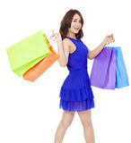 Smiling young woman walking and  holding shopping bags Stock Photos