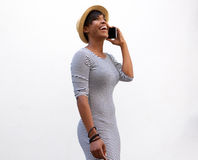 Smiling young woman walking and talking on cell phone Royalty Free Stock Photos