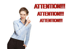 Smiling young woman warning about something Royalty Free Stock Images