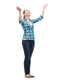 Smiling young woman waving hands. Happiness and people concept - smiling young woman waving hands Stock Image