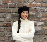 Smiling young woman wearing beret hat Royalty Free Stock Photos