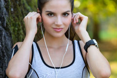 Smiling Young Woman Wearing Earphones royalty free stock image