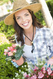 Smiling Young Woman Wearing Hat Gardening Outdoors Stock Images