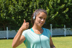 Smiling young woman wearing headphones with micophone. Royalty Free Stock Photos