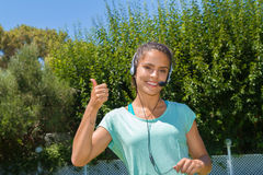 Smiling young woman wearing headphones with micophone. Stock Photos