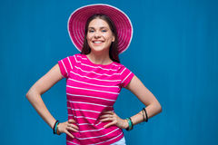 Smiling young woman wearing pink beach hat Stock Photos
