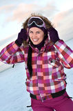 Smiling young woman wearing skiing suit Royalty Free Stock Photography