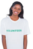 Smiling young woman wearing volunteer tshirt Royalty Free Stock Photography