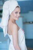 Smiling Young Woman Wearing White Bath Towel Stock Photography