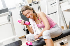 Smiling young woman weightlifting on the bench Royalty Free Stock Image
