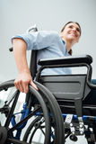 Smiling young woman in wheelchair Stock Photo
