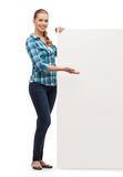 Smiling young woman with white blank board Stock Images