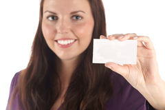 Smiling young woman with white blank card Stock Image