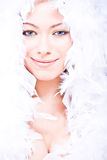 Smiling young woman with white boa over her Royalty Free Stock Photography