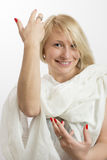 Smiling young woman with a white cloth and red nails. Portrait of smiling young woman with a white cloth and red nails Royalty Free Stock Photo