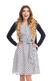Smiling Young Woman In White Dotted Dress And Cardigan Is Looking Up. Beautiful young woman in white dotted summer dress and blue cardigan is holding heads on Royalty Free Stock Image