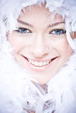 Smiling young woman with white downy boa Stock Photography