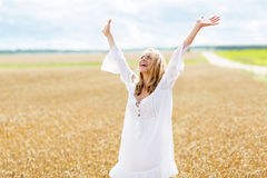 Smiling young woman in white dress on cereal field Stock Photography