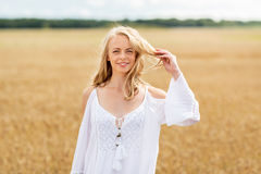 Smiling young woman in white dress on cereal field Royalty Free Stock Images