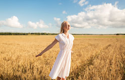 Smiling young woman in white dress on cereal field Royalty Free Stock Photography