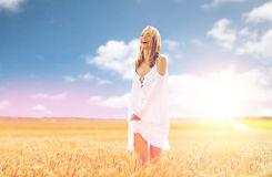 Smiling young woman in white dress on cereal field Royalty Free Stock Photo