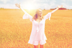Smiling young woman in white dress on cereal field. Country, nature, summer holidays, vacation and people concept - smiling young woman in white dress on cereal Stock Photos