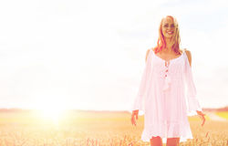 Smiling young woman in white dress on cereal field Stock Image
