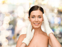 Smiling young woman in white mittens Stock Photo