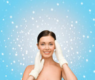 Smiling young woman in white mittens Royalty Free Stock Photo