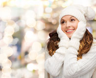 Smiling young woman in white winter clothes Royalty Free Stock Photos
