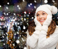 Smiling young woman in white winter clothes Stock Photography