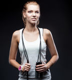 Smiling young woman whith jumping rope Stock Image