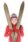 smiling young woman in winter cap holding old ski Stock Images